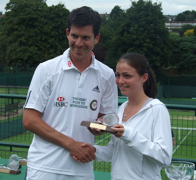 Amy Ellis being presented with her trophy by Tim Henman