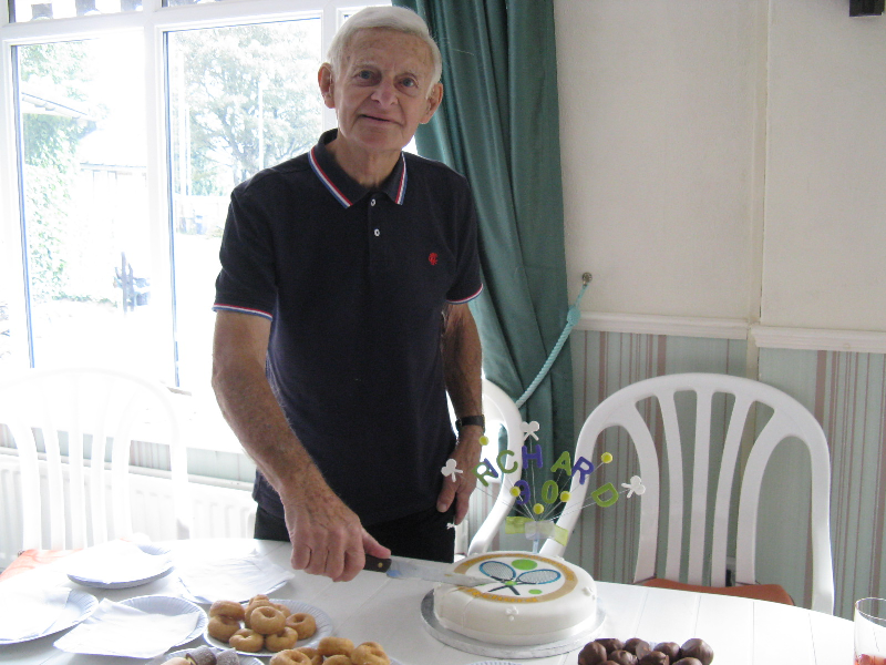 Cutting the cake on Richard's 90th birthday at Friday morning social tennis